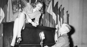 Vice President Harry S. Truman plays the piano for Lauren Bacall