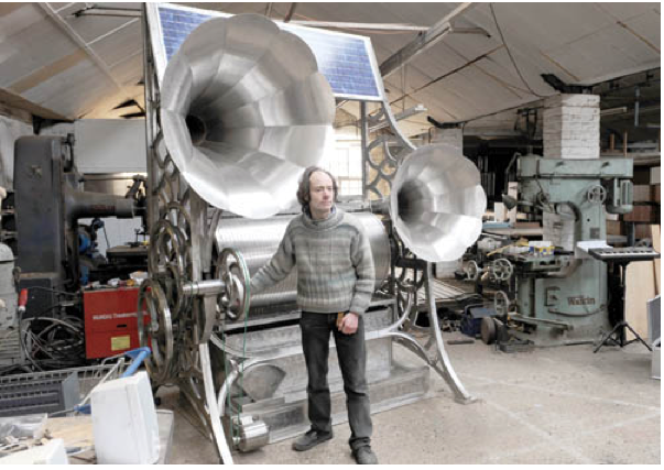 "Sound sculptor Henry Dagg and his sharpsichord, a solar-powered music box, sometimes called a pin-barrel harp. Its perforated cylinder contains 11,520 holes into which an artist can plug pins in order to create melodies. As the cylinder rotates, the pins pluck strings to create the sound. Dagg describes the sound as ""a cross between a harp and a bass clarinet."" Björk used the sharpsichord on her Biophilia album."