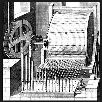 De Caus water organ, 1615. Not sure if this would have worked very well - the mechanics are very clumsy, and the water wheel drive is tremendously inefficient.