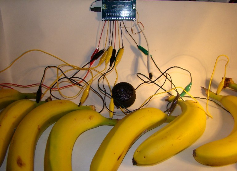 A bananophone - which is a makey-makey or similar circuit board, connected to bananas. Touching them makes the connection - like a keys on a piano. I have a similar setup, but unfortunately, the response time is slow, so I've found it difficult to use in performance.